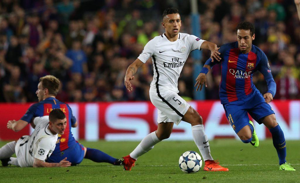Barcelona's Neymar in action with Paris Saint-Germain's Marquinhos.