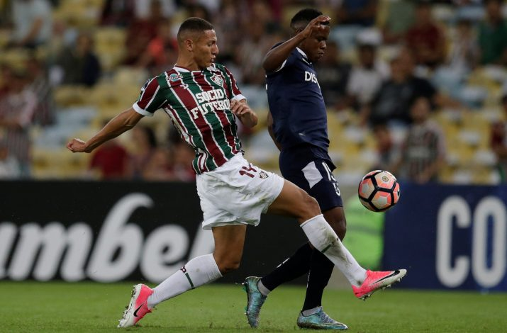 Richarlison of Fluminense and Gustavo Cortez of Universidad Catolica in action.
