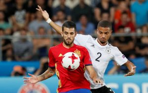 Spain's Dani Ceballos and Germany's Jeremy Toljan in action.