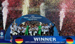 Germany's team members celebrate after winning the cup.