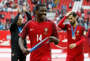 Portugal's William Carvalho celebrates with his medal after the game.