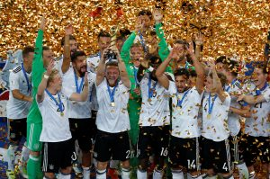 Germany's Shkodran Mustafi celebrates with the trophy and team mates after winning the FIFA Confederations Cup.