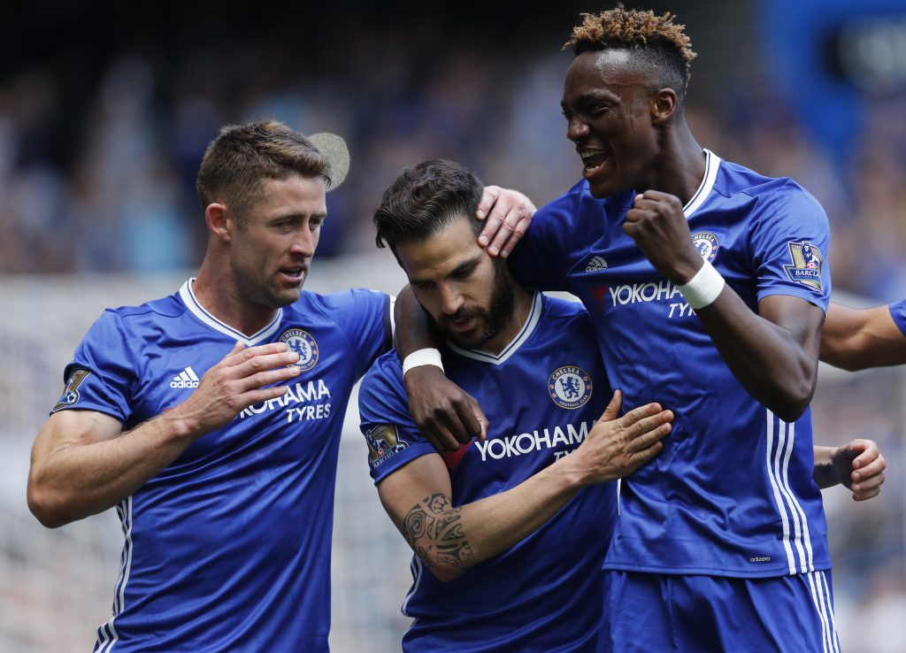 Chelsea's Cesc Fabregas celebrates scoring their first goal with Tammy Abraham and Gary Cahill.
