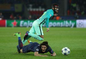 Paris Saint-Germain's Edinson Cavani in action with Barcelona's Rafinha.