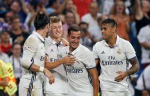 Real Madrid's Toni Kroos celebrates his goal with teammates Gareth Bale, Lucas Vazquez and Mariano Diaz.