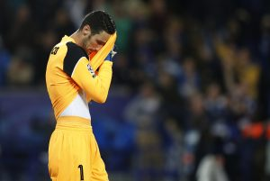 Sevilla's Sergio Rico looks dejected.