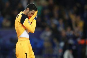 Sevilla's Sergio Rico looks dejected.