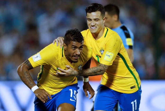 Brazil's Paulinho (L) celebrates his second goal with teammate Phillipe Coutinho.