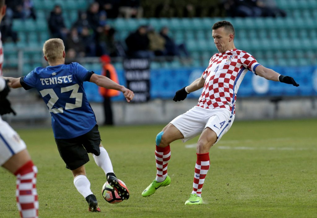 Ivan Perisic of Croatia in action with Taijo Teniste of Estonia.