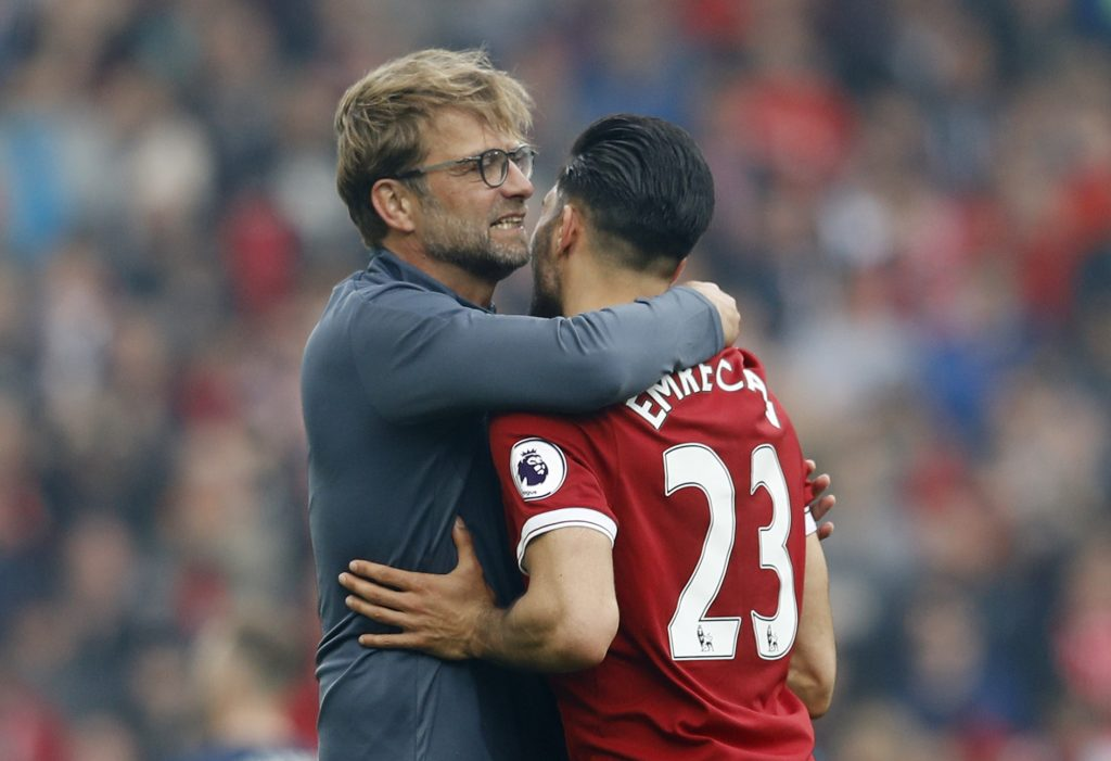 Liverpool manager Jurgen Klopp and Emre Can celebrate after the match.