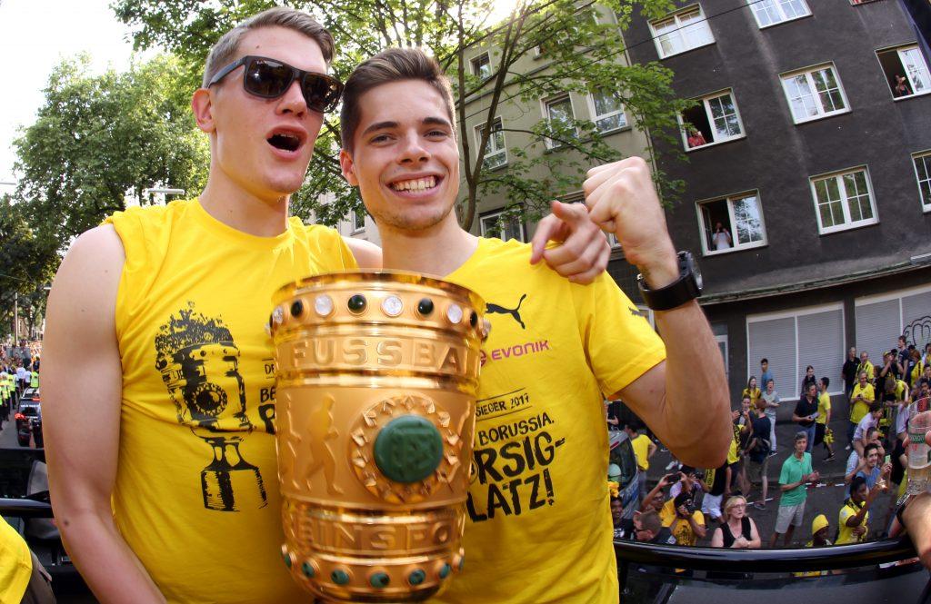 Matthias Ginter (l) and Julian Weigl of Borussia Dortmund celebrate their German Soccer Cup Final victory.
