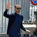 Leonardo Bonucci waves as he arrives at the Caselle airport in Turin, Italy.