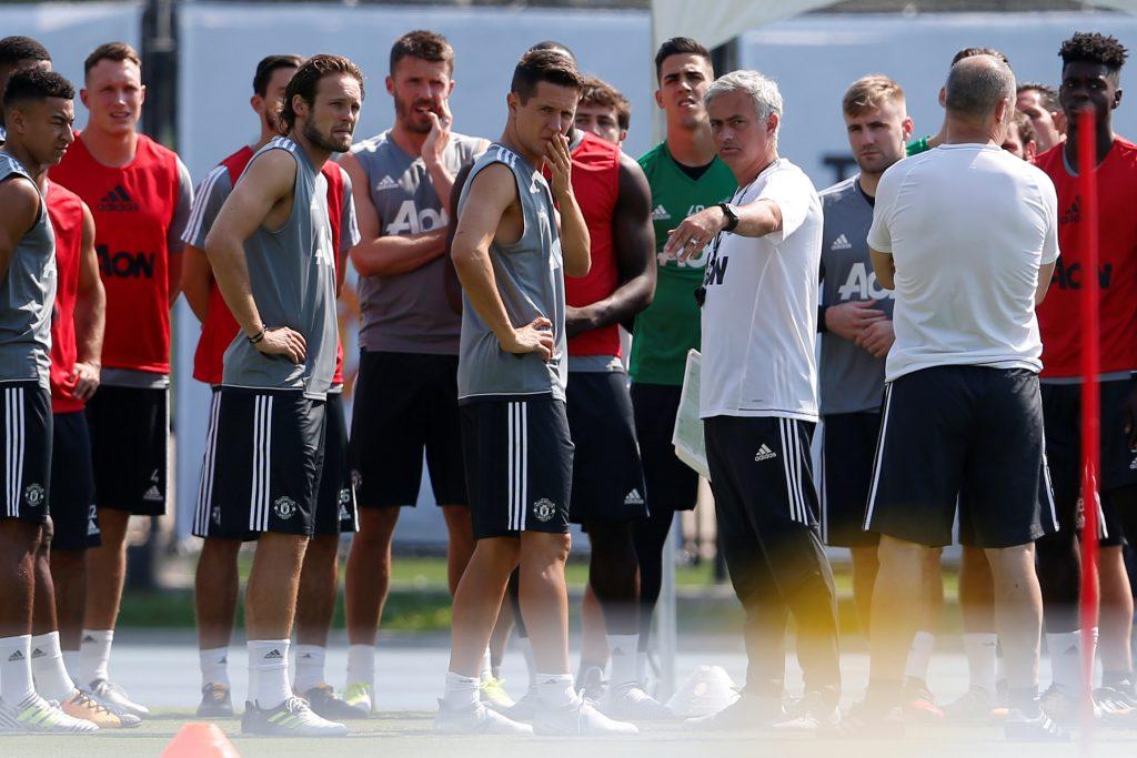 Manchester United's Jose Mourinho (C-R) directs training.