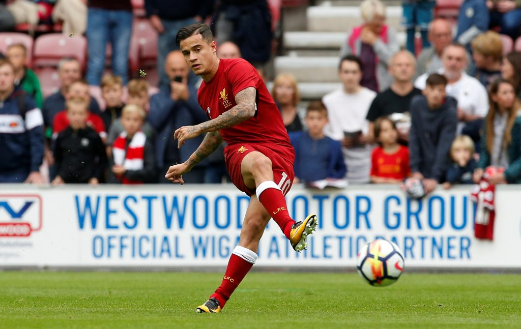Liverpool's Philippe Coutinho warms up before the match.