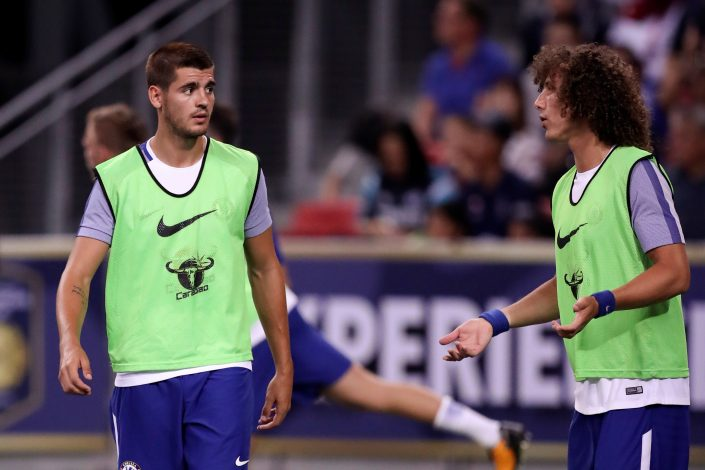 Chelsea's Alvaro Morata warms up with David Luiz.