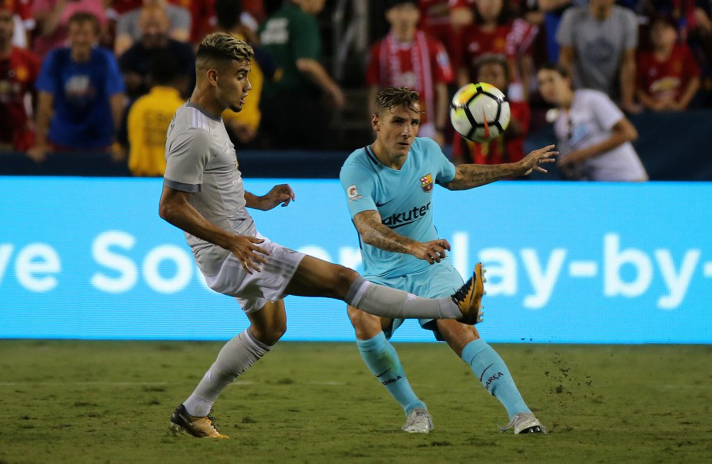 Manchester United's Andreas Pereira in action with Barcelona's Lucas Digne.