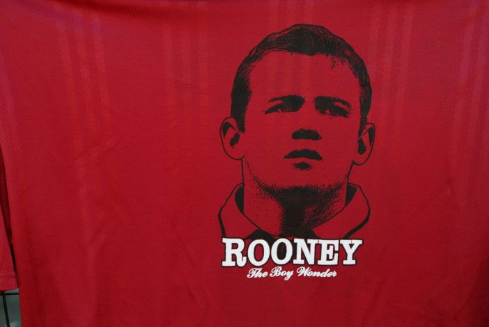 T-shirts showing the face of England striker Wayne Rooney.