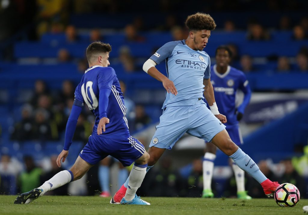Chelsea's Mason Mount and Man City's Jadon Sancho challenge for the ball.