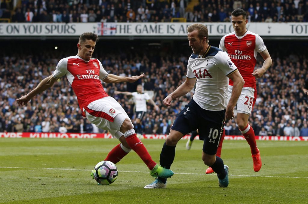 Harry Kane is brought down by Gabriel Paulista for a penalty.