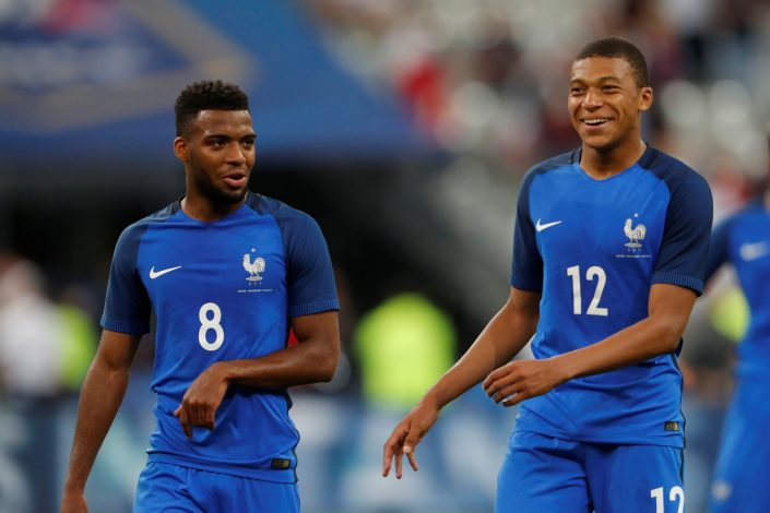 France's Kylian Mbappe celebrates with Thomas Lemar at the end of the match.