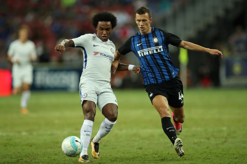 Chelsea's Willian in action with Inter Milan's Ivan Perisic.