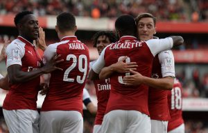 Arsenal's Alexandre Lacazette celebrates scoring their first goal with team mates.