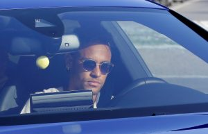 Neymar drives to arrive to Joan Gamper training camp near Barcelona.