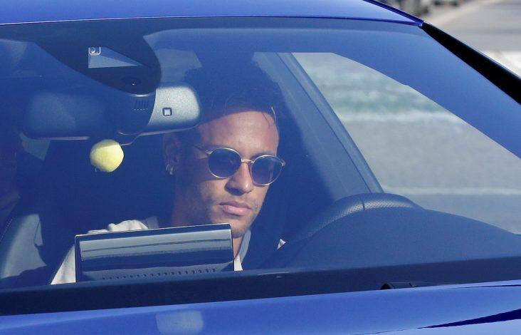 Neymar drives to arrive to Joan Gamper training camp near Barcelona.