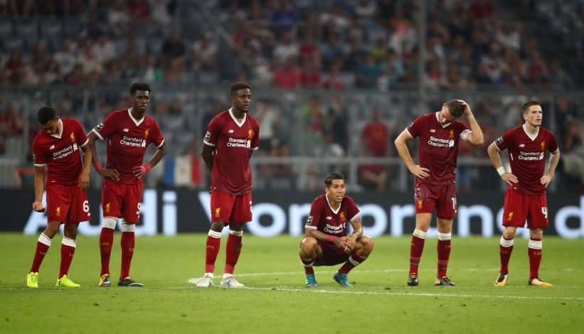 Liverpool players look dejected during the penalty shootout.