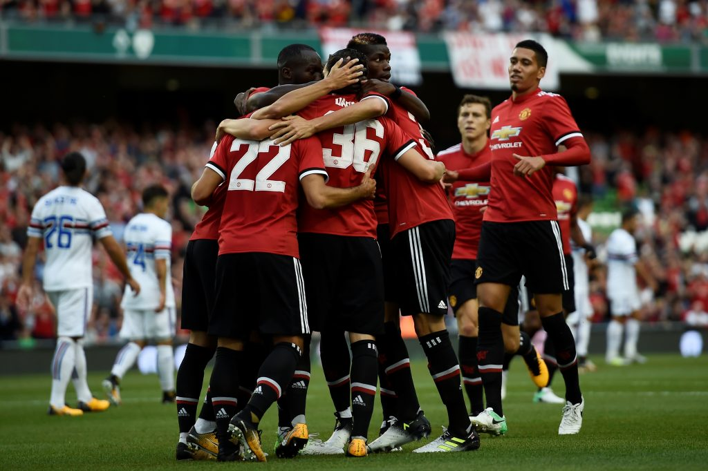 Manchester United's Henrikh Mkhitaryan celebrates scoring their first goal with team mates.