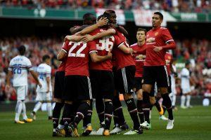 Manchester United's Henrikh Mkhitaryan celebrates scoring their first goal with team mates.