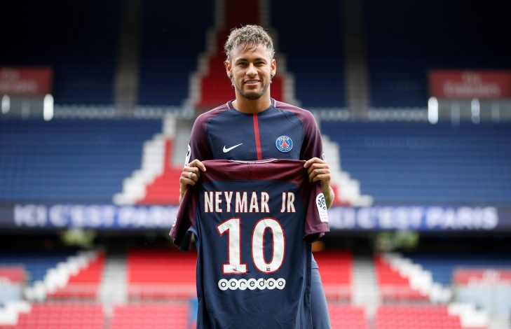 New Paris Saint-Germain signing Neymar Jr poses with the club shirt.