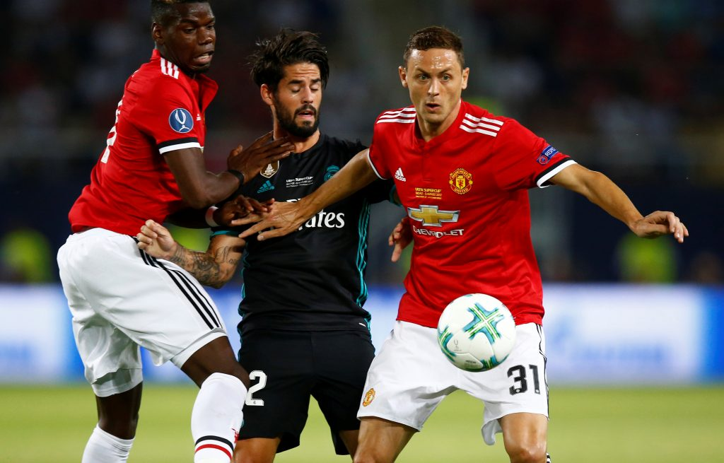 Isco in action with Nemanja Matic and Paul Pogba.