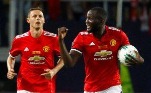 Manchester United's Romelu Lukaku celebrates scoring their first goal with Nemanja Matic.