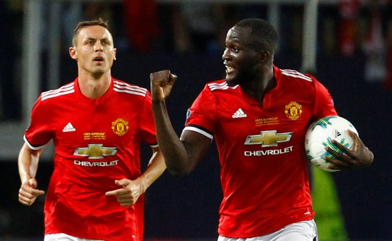 Manchester United's Romelu Lukaku celebrates scoring their first goal with Nemanja Matic.