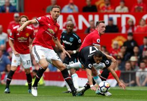 Javier Hernandez in action with Nemanja Matic and Phil Jones.