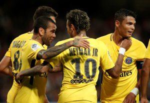 Paris Saint-Germain's Neymar celebrates with Dani Alves and Thiago Silva.