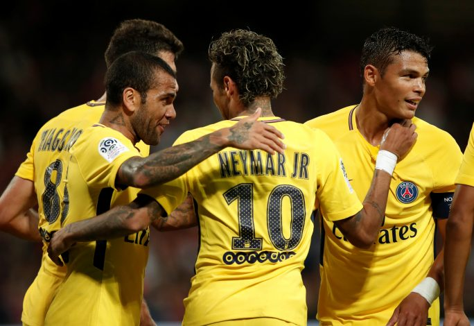 Paris Saint-Germain's Neymar celebrates with Dani Alves and Thiago Silva.