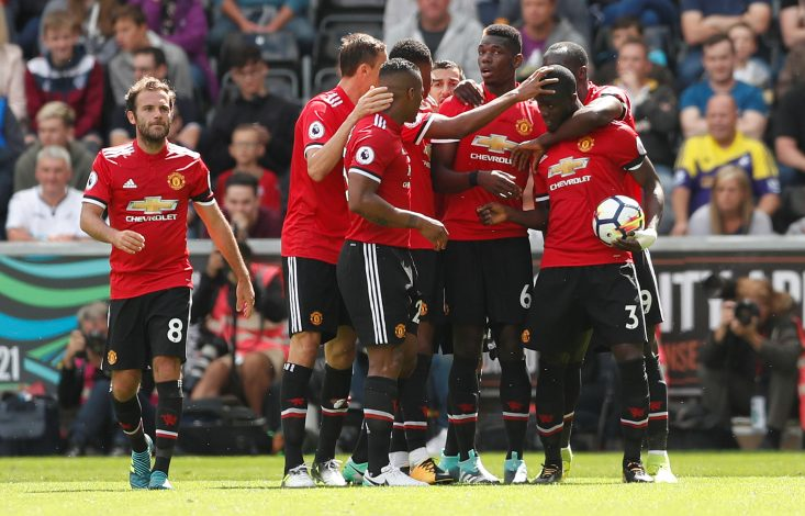 Manchester United's Eric Bailly celebrates scoring their first goal with team mates.