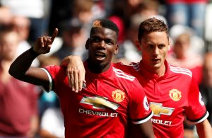 Paul Pogba celebrates with Nemanja Matic.
