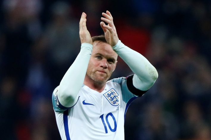 ngland's Wayne Rooney applauds fans after the game.