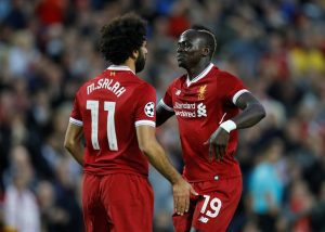 Liverpool's Mohamed Salah celebrates scoring their second goal with Sadio Mane.
