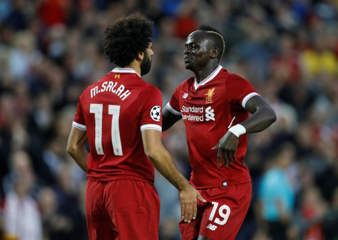 Liverpool's Mohamed Salah celebrates scoring their second goal with Sadio Mane.
