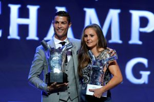 Real Madrid's Cristiano Ronaldo and Barcelona's Lieke Martens hold their trophies.