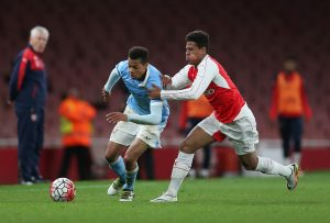 Arsenal's Marcus McGuane and Manchester City's Lukas Nmecha in action.
