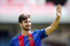 FC Barcelona's Andre Gomes waves to the crowd.