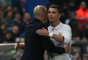 Cristiano Ronaldo and Real Madrid coach Zinedine Zidane hug.