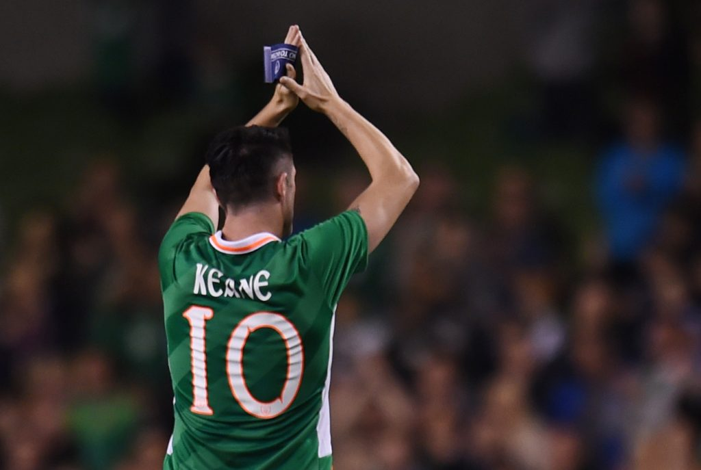 Republic of Ireland's Robbie Keane applauds fans as he walks off to be substituted.