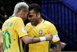 Neymar (L) of Brazil celebrates with team mate Dani Alves after scoring a goal against Colombia.