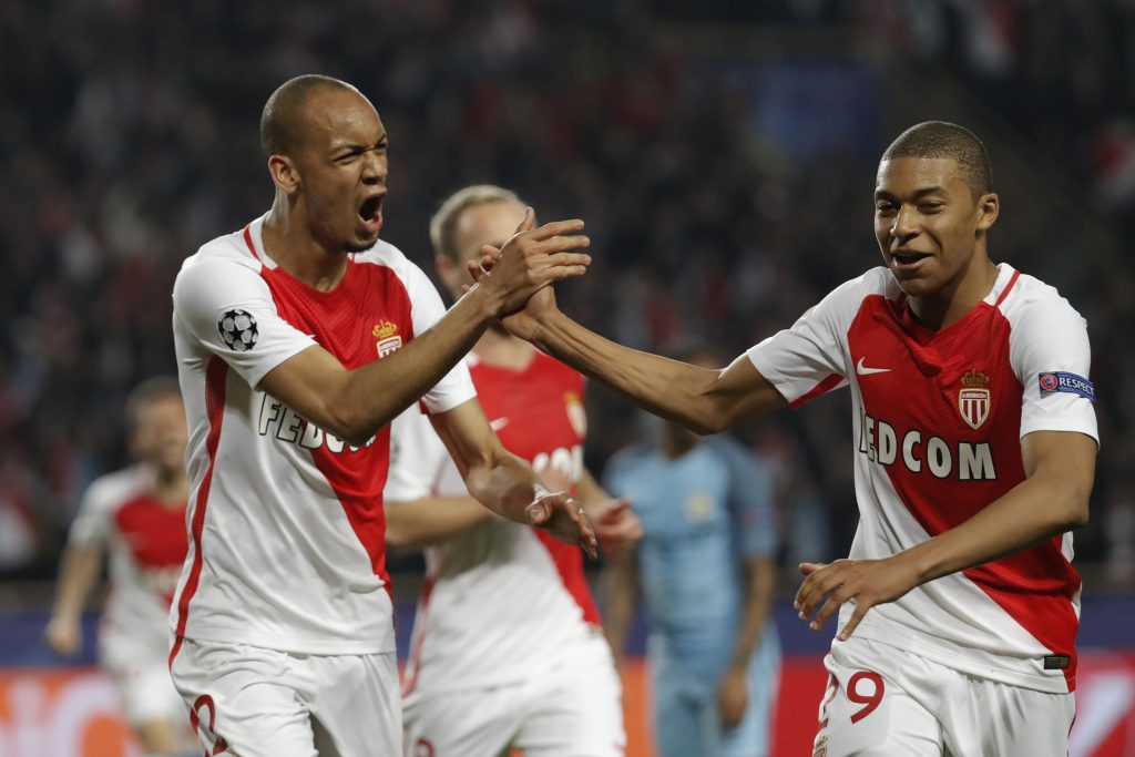 Monaco's Fabinho celebrates with Kylian Mbappe-Lottin.